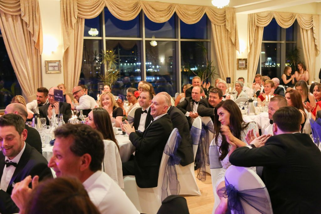 a selection of tables and guests at the Ascot Group Summer Ball event
